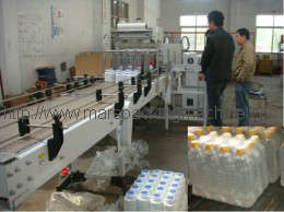 Shrink Wrapping Machine for Bottles with Bottom Paper Pad